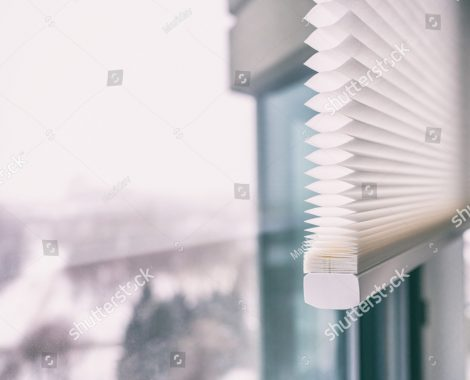 stock-photo-home-blinds-cordless-cellular-honeycomb-pleated-shade-modern-shades-on-apartment-windows-1302456547
